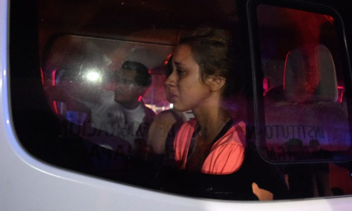 Migrants are seen inside a van after being recaptured near the Siglo XXI immigrant detention center after a large group of Cubans, Haitians and Central Americans broke out and escaped the facilities, in Tapachula, Mexico, on April 25, 2019. (Jose Torres/Reuters)