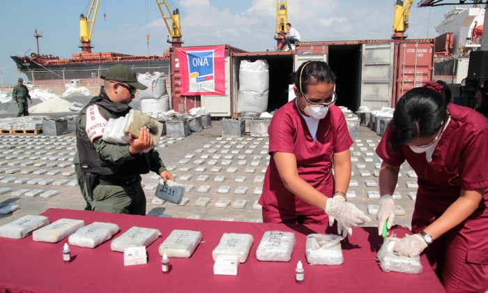 Criminology specialists test cocaine seized in Maracaibo, Venezuela, on April 25, 2013.   JIMMY PIRELA/AFP/Getty Images