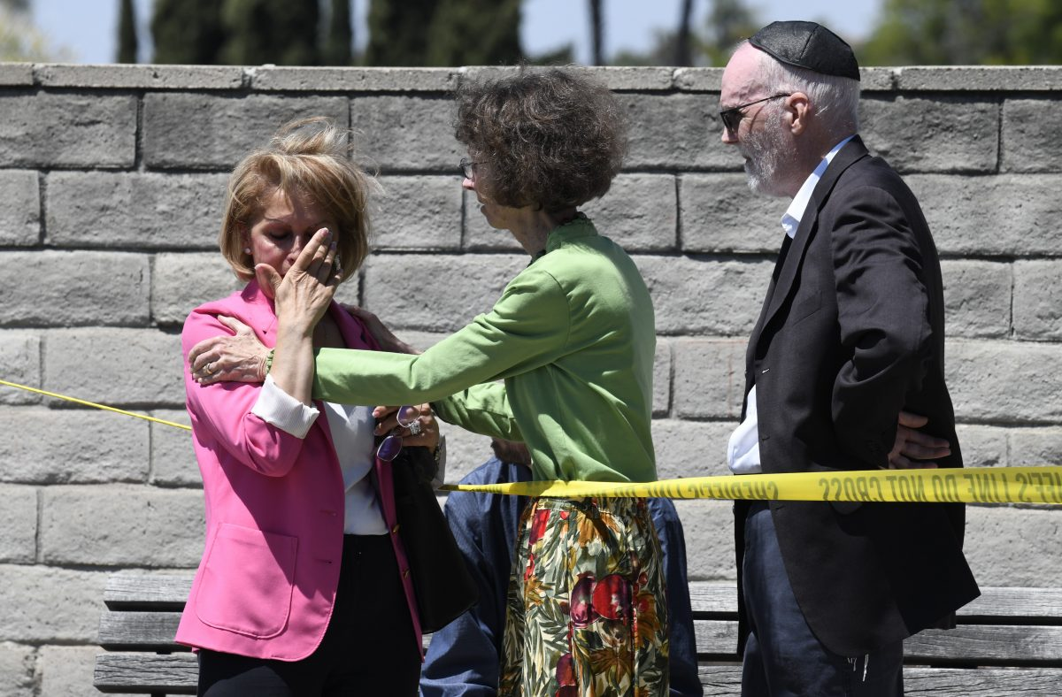 Synagogue members console one another