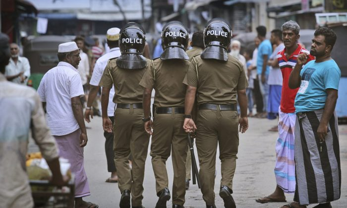 Sri Lankan policeman patrol in a Muslim neighborhood before Friday prayers in Colombo, Sri Lanka on April 26, 2019. (Manish Swarup/AP)