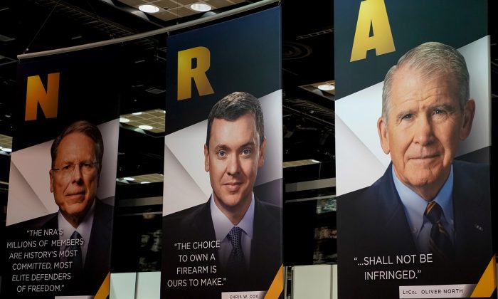 NRA CEO Wayne LaPierre, Legislative Director Chris Cox and President Oliver North displayed during the National Rifle Association (NRA) annual meeting at the Indiana Convention center in Indianapolis, Indiana, U.S., on April 27, 2019.  (Bryan Woolston/Reuter)