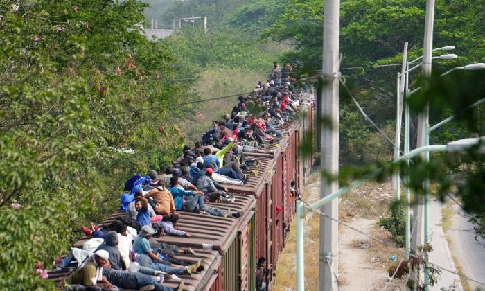 "Central American migrants, moving in a caravan through Juchitan, Oaxaca are pictured atop a train known as ""The Beast"" while continuing their journey toward the United States, in Mexico, on April 26, 2019. (Jose Cortes/Reuters)"