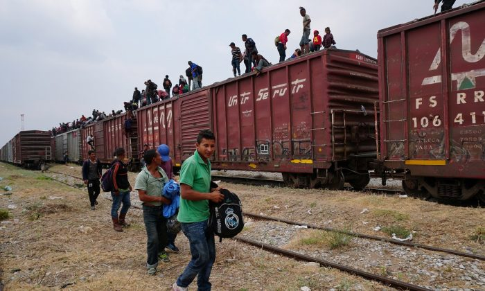 "Central American migrants ride atop a train known as ""The Beast"", on their journey towards the United States, in Ixtepec, Mexico on April 26, 2019. (Jose Cortes/REUTERS)"