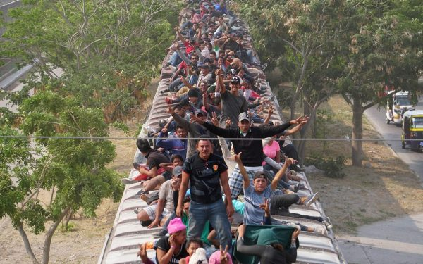 Central American migrants, moving in a caravan through Juchitan,