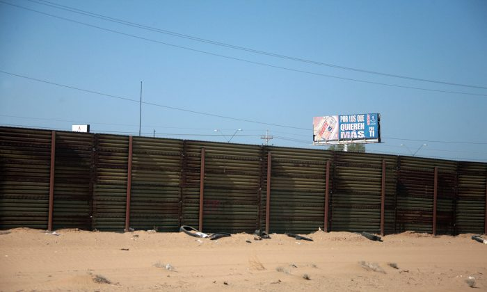 Corrugated steel border fence in the Yuma Border Sector in San Luis, Ariz., on April 9, 2007. (Jim Watson/AFP/Getty Images)