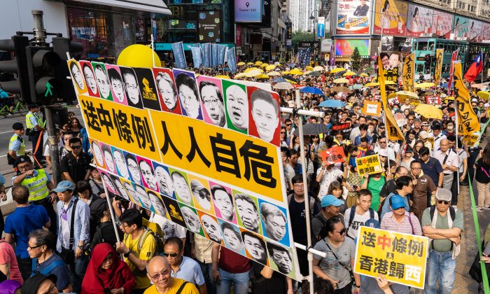Hong Kongers protest proposed amendments to the city's extradition laws, which would allow suspects to be sent to mainland China, on April 28, 2019. (Poon Zoi-Syu/Epoch Times)
