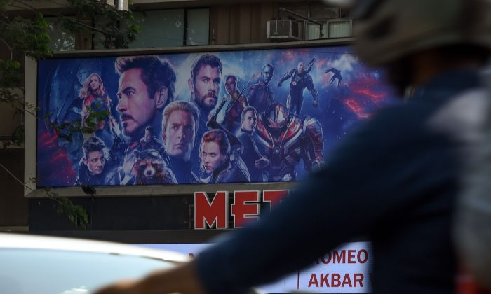 Vehicles go past a movie theater displaying a poster of the latest Avengers movie, in Mumbai, India, on April 25, 2019. (Indranil Mukherjee/AFP/Getty Images)