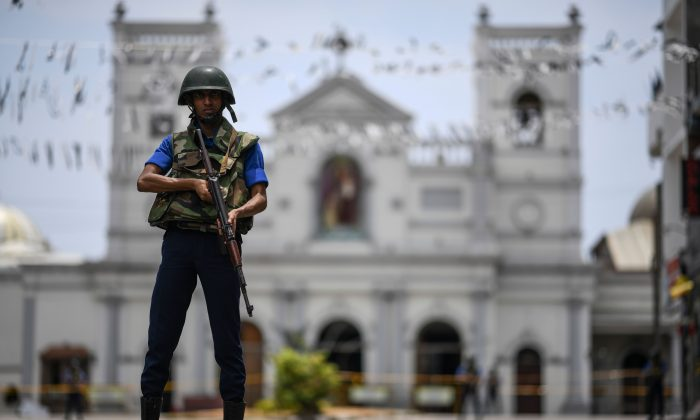 A soldier stands guard outside St. Anthony's Shrine in Colombo on April 25, 2019, following a series of bomb blasts targeting churches and luxury hotels on the Easter Sunday in Sri Lanka. JEWEL SAMAD/AFP/Getty Images