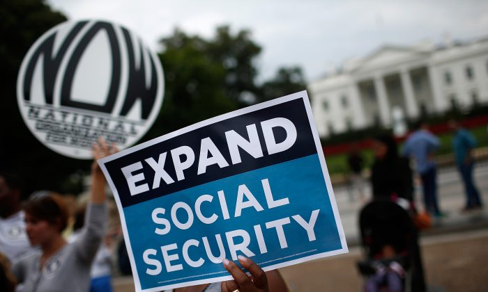 Activists participate in a rally urging the expansion of Social Security benefits in front of the White House in Washington on July 13, 2015. (Win McNamee/Getty Images)