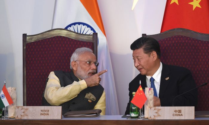 India Prime Minister Narendra Modi (Left) gestures while talking with China's President Xi Jinping during the BRICS leaders' meeting with the BRICS Business Council at the Taj Exotica hotel in Goa on October 16, 2016. (PRAKASH SINGH/AFP/Getty Images)