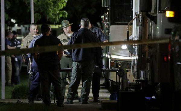 investigators work a crime scene