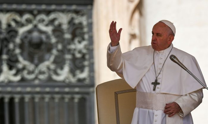 Pope Francis waves to pilgrims upon his arrival on stage at St. Peter's Square in The Vatican on April 24, 2019, during his weekly general audience. (VINCENZO PINTO/AFP/Getty Images)