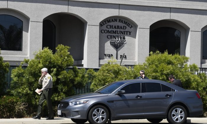 San Diego County Sheriff Bill Gore, left, walks past the Chabad of Poway Synagogue in Poway, Calif., on April 27, 2019. (Denis Poroy/Photo via AP)