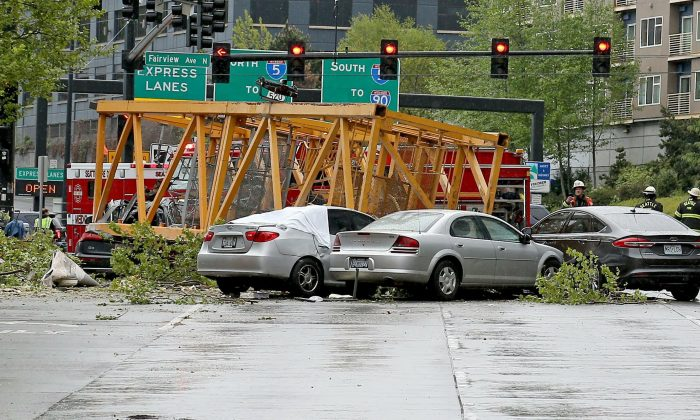 A construction crane fell into eastbound and westbound Mercer Street near Fairview Avenue East , in Seattle on April 27, 2019. (Greg Gilbert/The Seattle Times via AP)