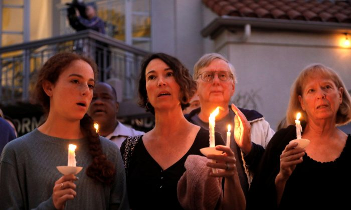 A candlelight vigil is held at Rancho Bernardo Community Presbyterian Church for victims of a shooting incident at the Congregation Chabad synagogue in Poway, Calif., on April 27, 2019. REUTERS/John Gastaldo