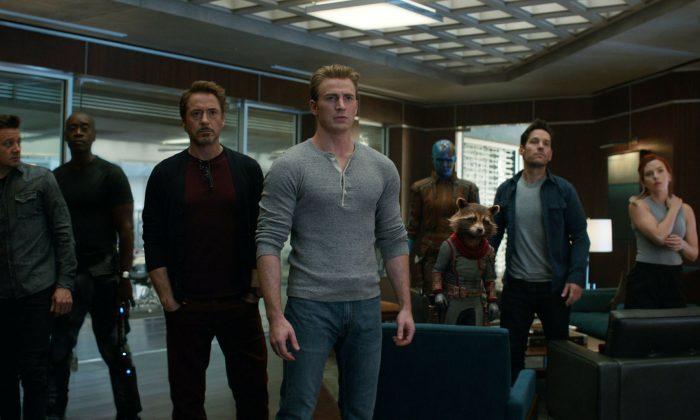 """From left, Jeremy Renner, Don Cheadle, Robert Downey Jr., Chris Evans, Karen Gillan, the character Rocket, voiced by Bradley Cooper, Paul Rudd and Scarlett Johansson in a scene from """"Avengers: Endgame."""" (Disney/Marvel Studios via AP)"""