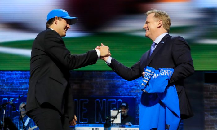 T.J. Hockenson of Iowa greets NFL Commissioner Roger Goodell after being chosen No. 8 overall by the Detroit Lions during the first round of the 2019 NFL Draft in Nashville, Tenn., on April 25, 2019 . Andy Lyons/Getty Images