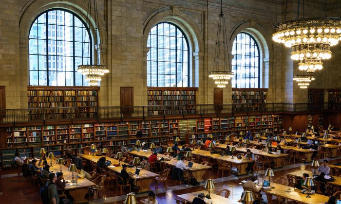 People work at desks in the Rose Main Reading Room at the New York Public Library, October 5, 2016 in New York City.  Drew Angerer/Getty Images