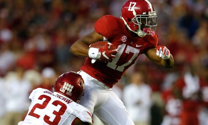 Kenyan Drake No. 17 of the Alabama Crimson Tide is tackled by Dre Greenlaw No. 23 of the Arkansas Razorbacks at Bryant-Denny Stadium in Tuscaloosa, Ala., on Oct. 10, 2015. (Kevin C. Cox/Getty Images)