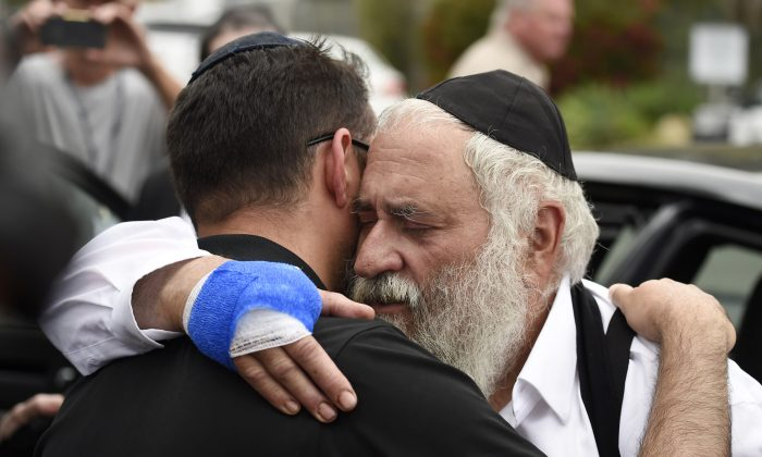 Rabbi Yisroel Goldstein, right, is hugged as he leaves a news conference at the Chabad of Poway synagogue in Poway, Calif., on April 28, 2019. (AP Photo/Denis Poroy)