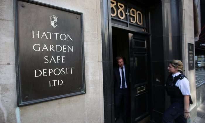 A policewoman enters a Hatton Garden safe deposit center in London, England on April 7, 2015. The underground safety deposits were robbed by the 'Bad Grandpas.' (Peter Macdiarmid/Getty Images)