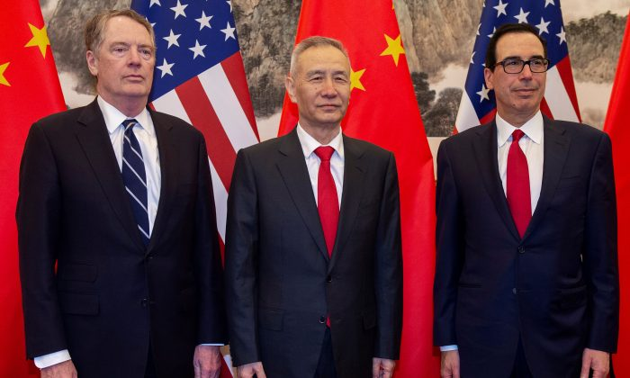 China's Vice Premier Liu He (C) pose for a photo with U.S. Treasury Secretary Steven Mnuchin (R) and U.S. Trade Representative Robert Lighthizer (L) at Diaoyutai State Guesthouse in Beijing on March 29, 2019. (Nicolas Asfouri/Pool via Reuters)
