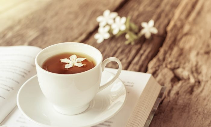 A great way to take care of Mom is to give her some time for relaxation, perhaps with a cup of tea and a good book. (nednapa/Shutterstock)