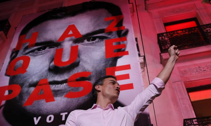 Spain's Prime Minister and Socialist Party leader Pedro Sanchez gestures to supporters outside the party headquarters following the general election in Madrid, Spain, on April 28, 2019.  (Bernat Armangue/AP Photo)