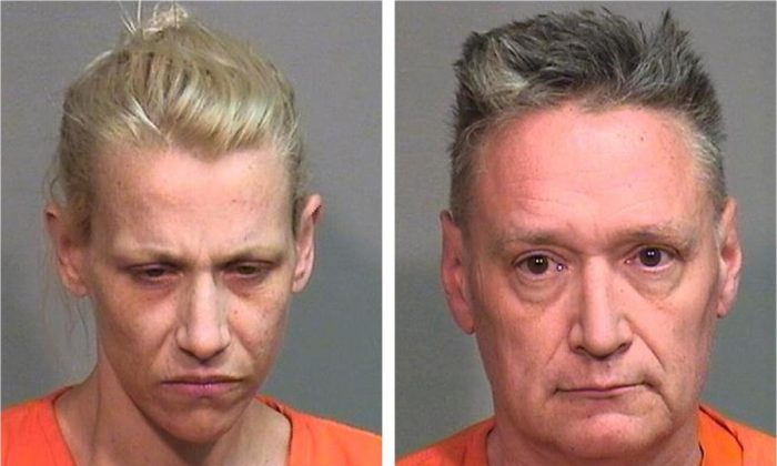 Police booking photos of JoAnn Cunningham and Andrew Freund Sr. who face multiple charges in the death of their 5-year-old son. (McHenry County Sheriff's Department via AP)