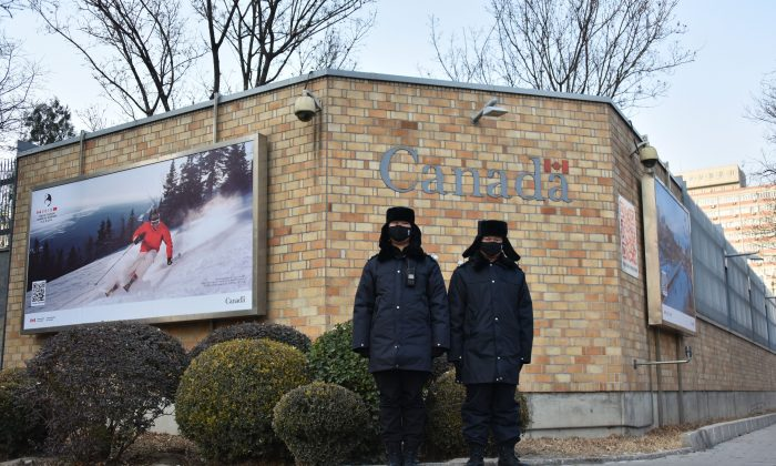 Chinese police officers stand guard outside the Canadian Embassy in Beijing on Dec. 10, 2018. (Greg Baker/AFP/Getty Images)