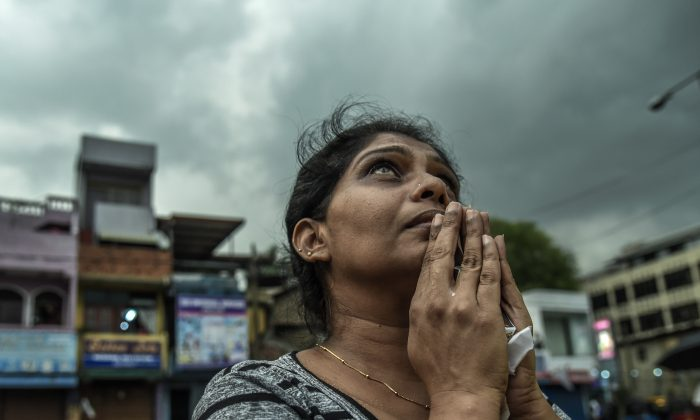 Sri Lankan local people pray near to St Anthony Church on April 23, 2019 evening in Colombo, Sri Lanka.  Atul Loke/Getty Images