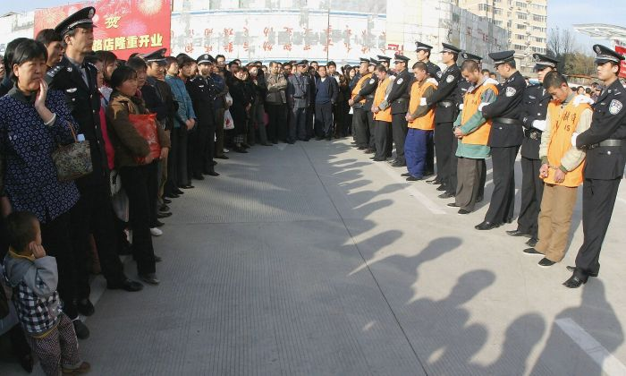 Chinese police parade a group of 15 convicted criminals to be sentenced in public, most of which are likely to face the death penalty, on November 15, 2004 in Xian, China. (China Photos/Getty Images)