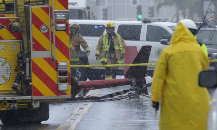 A portion of the tail section of a helicopter is shown after crashing in Kailua, Hawaii, and killing three people onboard on April 29, 2019. (Bruce Asato/Honolulu Star-Advertiser via The Associated Press)