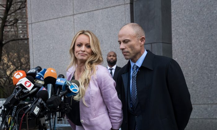 (L to R) Stormy Daniels (Stephanie Clifford) and Michael Avenatti, attorney for Stormy Daniels, speak to the media as they exit the United States District Court Southern District of New York for a hearing related to Michael Cohen, President Trump's longtime personal attorney and confidante, in New York City on April 16, 2018. (Drew Angerer/Getty Images)