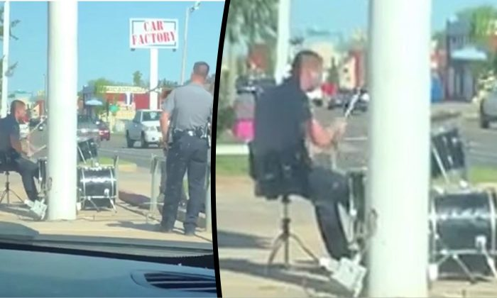 Oklahoma City police Officer Nate Ross is seated at a drum kit during a noise complaint response in South Oklahoma City, on April 26, 2019. (Oklahoma City Police Department)