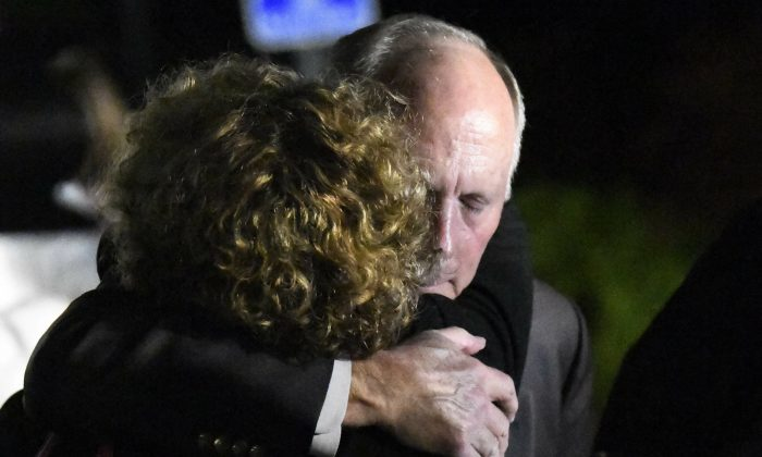 UNC Charlotte Chancellor Philip DuBois is hugged in Charlotte, N.C., on April 30, 2019. (David T. Foster III/The Charlotte Observer via AP)