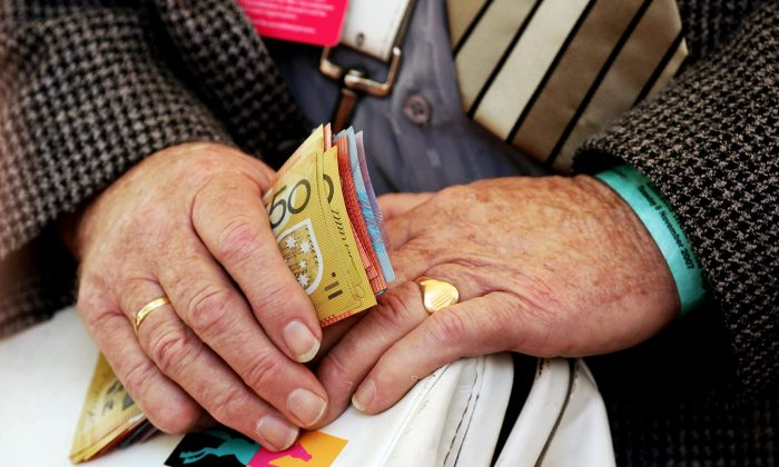 A bookie holds money at The Melbourne Cup Carnival meeting at Flemington Racecourse Nov. 6, 2007 in Melbourne, Australia. (Quinn Rooney/Getty Images)