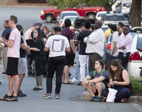 People gather across from the campus of UNC Charlotte