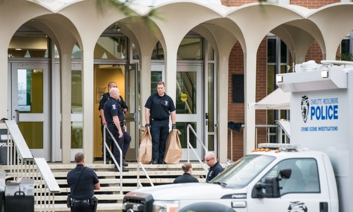 Charlotte-Mecklenburg law enforcement stand in front of the Kennedy building where a gunman killed two people and injured four students at UNC Charlotte in Charlotte, N.C., on May 1, 2019. (Sean Rayford/Getty Images)