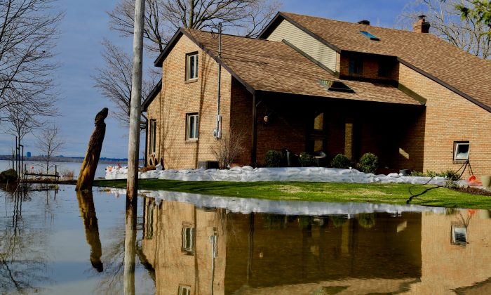 A flooded home next to the Ottawa River near Saratoga, Gatineau in Quebec on April 30, 2019. (Jonathan Ren/The Epoch Times)