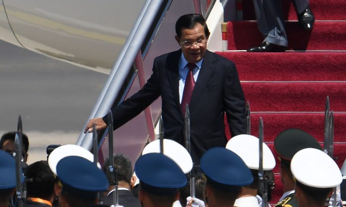 Cambodian leader Hun Sen arrives at Beijing airport to attend the Belt and Road Forum in Beijing on April 25, 2019. (Greg Baker-Pool/Getty Images)