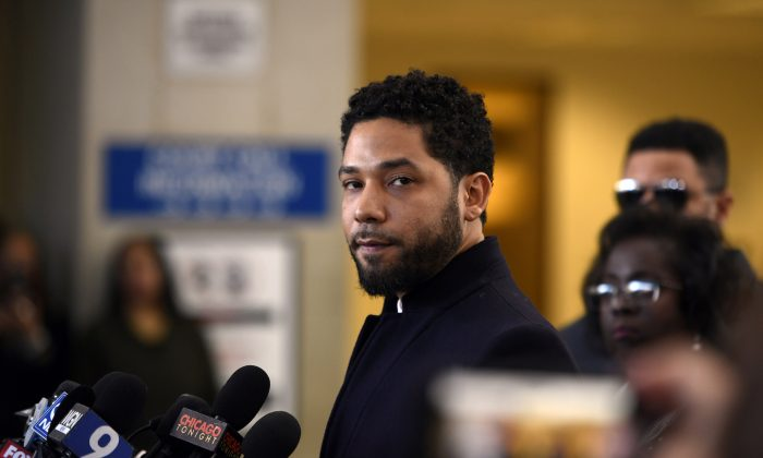 Actor Jussie Smollett talks to the media before leaving Cook County Court after his charges were dropped, in Chicago, on March 26, 2019. (AP Photo/Paul Beaty, File)