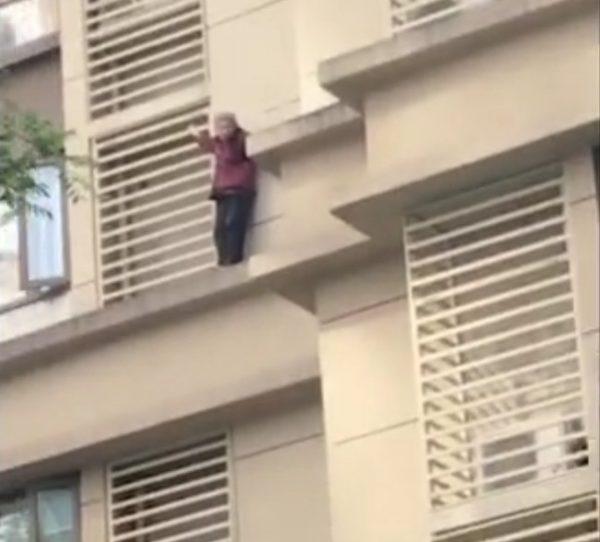 Woman climb building