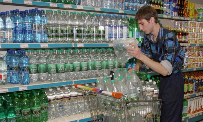 An employee stacks bottles of drinking water at a store. (Yuri Tutov/AFP/Getty Images)