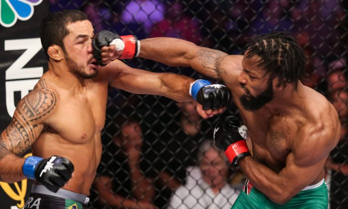 Andre Harrison (R) lands a punch during the PFL 8 playoffs in New Orleans, Louisiana in 2018. (Courtesy of the Professional Fighters League)