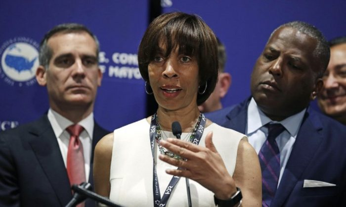 Baltimore Mayor Catherine Pugh addresses a gathering during the annual meeting of the U.S. Conference of Mayors in Boston, on June 8, 2018. (Charles Krupa/AP Photo)