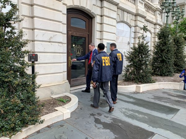 Federal Bureau of Investigation and Internal Revenue Service agents enter City Hall