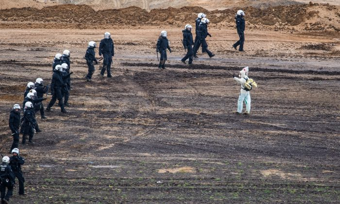 Police blocks environmental protesters at the open-cast brown coal mining Hambach near Kerpen, Germany, on Nov. 5, 2017.   Lukas Schulze/Getty Images
