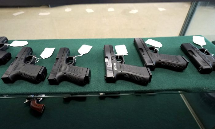 A selection of Glock pistols are seen for sale at the Pony Express Firearms shop in Parker, Colo., on Dec. 7, 2015. (Rick Wilking/Reuters)