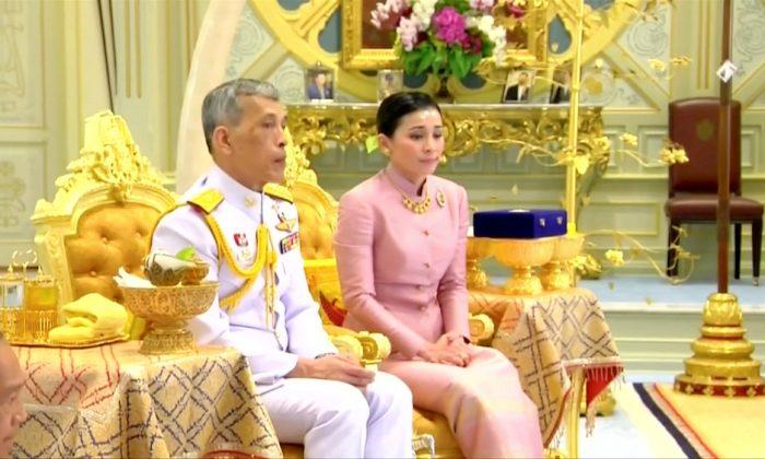 King Maha Vajiralongkorn and his consort, General Suthida Vajiralongkorn named Queen Suthida attend their wedding ceremony in Bangkok, Thailand May 1, 2019. (Thai TV Pool)